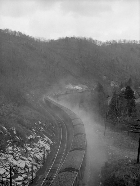 2018.15.N79.6213F--ed wilkommen 3x4 neg--N&W--coal freight train scene with brake shoe smoke--location unknown--no date