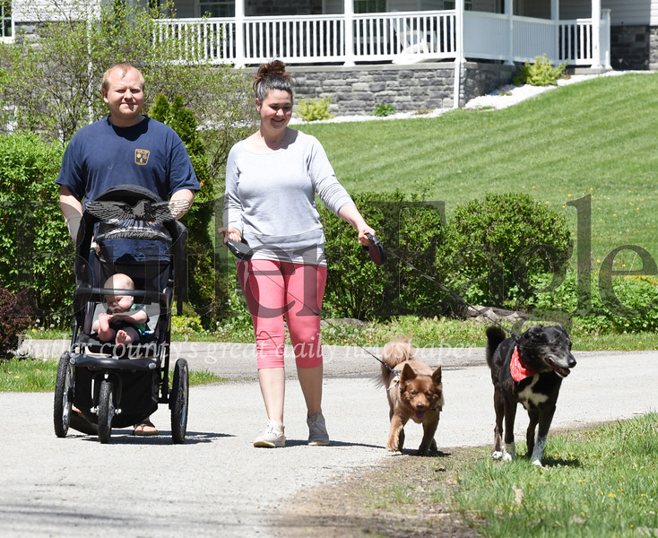 Harold Aughton/Butler Eagle: Alan and Emily Troyan of Penn. Twp. take their 7-month-old son, Noah, and family dogs, Mia and Sunshine for an afternoon walk, Monday, April 6.