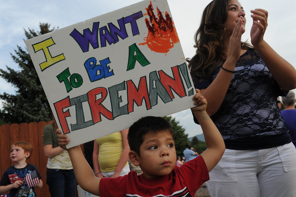 . Natalie DeHerrera and her son Isaac, 4, greet firefighters at the corner of 31Street and Fontanero Street in Colorado Springs, CO, Thursday, July 05, 2012. The family wanted to show their appreciation for those fighting the Waldo Canyon Fire. The fire has burned 18,247 acres and is 95 percent contained. Craig F. Walker, The Denver Post