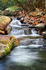 Beautiful waterfall in the middle of the forest during autumn.
