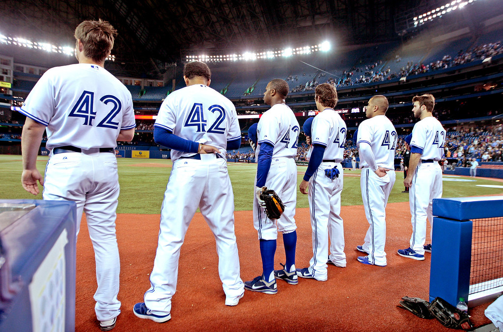 . The Toronto Blue Jays stand for the National Anthem before action against the Baltimore Orioles during MLB action at the Rogers Centre April 15, 2012 in Toronto, Ontario, Canada. Both teams wore the number 42 in honor of Jackie Robinson Day. (Photo by Abelimages/Getty Images)