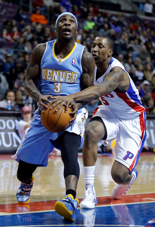 . Detroit Pistons guard Kentavious Caldwell-Pope (5) knocks the ball away from Denver Nuggets guard Ty Lawson (3) during the first half of an NBA basketball game on Saturday, Feb. 8, 2014, in Auburn Hills, Mich. (AP Photo/Duane Burleson)