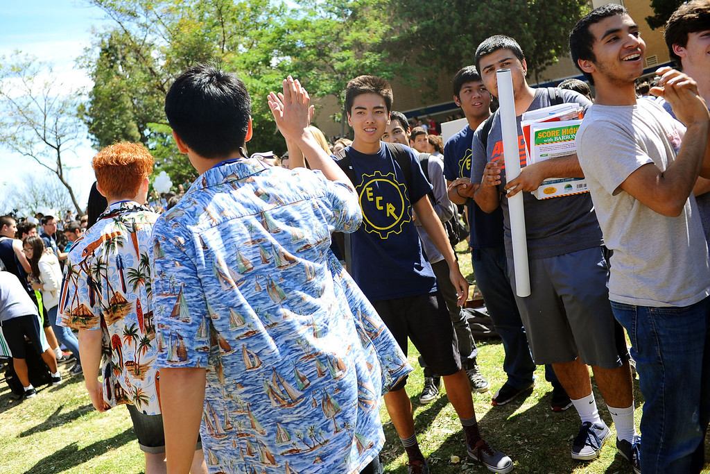 . The El Camino Real Charter High School\'s Academic Decathlon team makes thier way to a rally in honor of their seventh national title last week in Honolulu, Hawaii May 1, 2014.(Andy Holzman/Los Angeles Daily News)