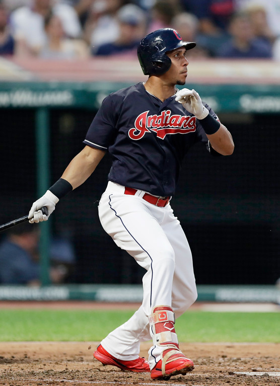 . Cleveland Indians\' Michael Brantley hits a single in the third inning of a baseball game against the Minnesota Twins, Tuesday, Aug. 28, 2018, in Cleveland. (AP Photo/Tony Dejak)
