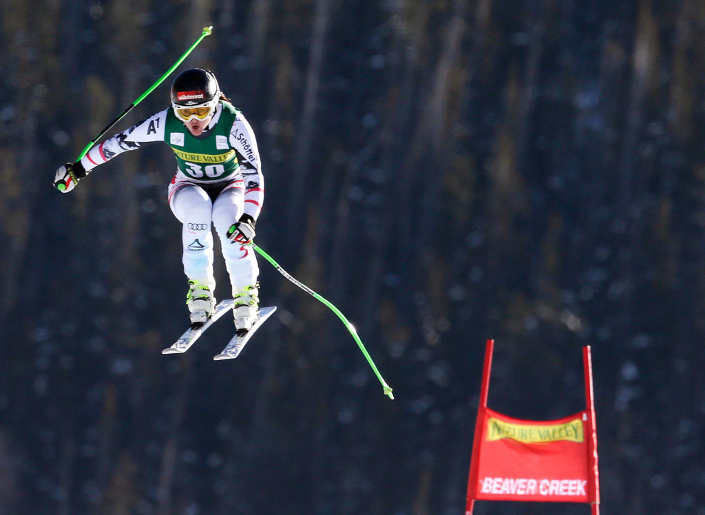 . Austria\'s Elisabeth Goergl flies off the last jump during the women\'s World Cup Downhill skiing event, Friday, Nov. 29, 2013, in Beaver Creek, Colo. (AP Photo/Charles Krupa)