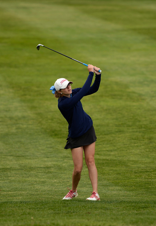 . Andrea Ballou, of Valor High School, chips onto the green on hole 12 during the first round of the Colorado State Girls 4A Golf Tournament at Broken Tee Golf Course in Englewood, May 20, 2013. (Photo By RJ Sangosti/The Denver Post)
