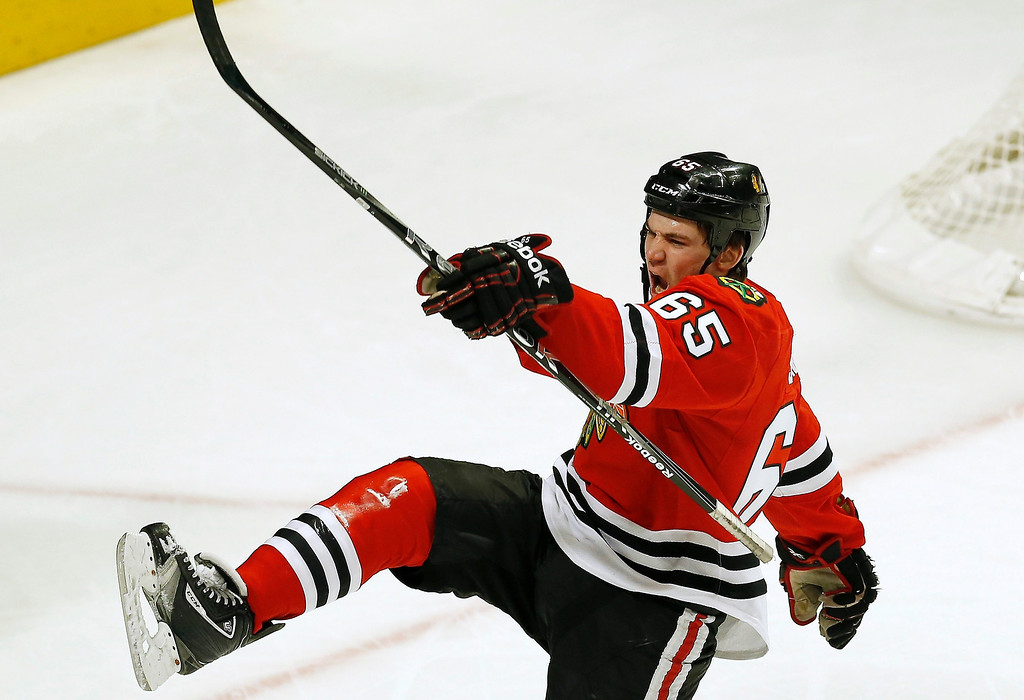 . Chicago Blackhawks\' Andrew Shaw celebrates his goal against the Colorado Avalanche during the first period of their NHL hockey game in Chicago, Illinois, March 6, 2013. REUTERS/Jim Young