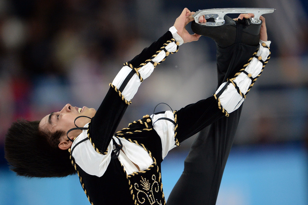 . Philippines\' Michael Christian Martinez performs during the Men\'s Figure Skating Short Program at the Iceberg Skating Palace during the Sochi Winter Olympics on February 13, 2014.   YURI KADOBNOV/AFP/Getty Images