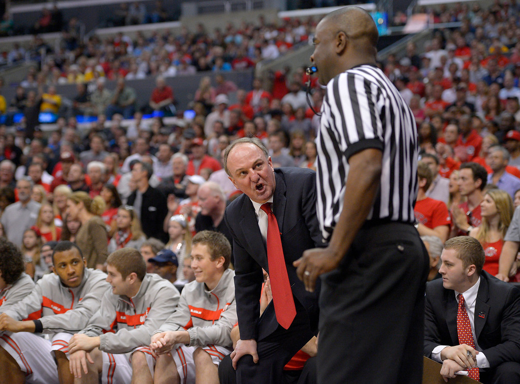 . Ohio State head coach Thad Matta argues a call during the first half of the West Regional final against Wichita State in the NCAA men\'s college basketball tournament, Saturday, March 30, 2013, in Los Angeles. (AP Photo/Mark J. Terrill)