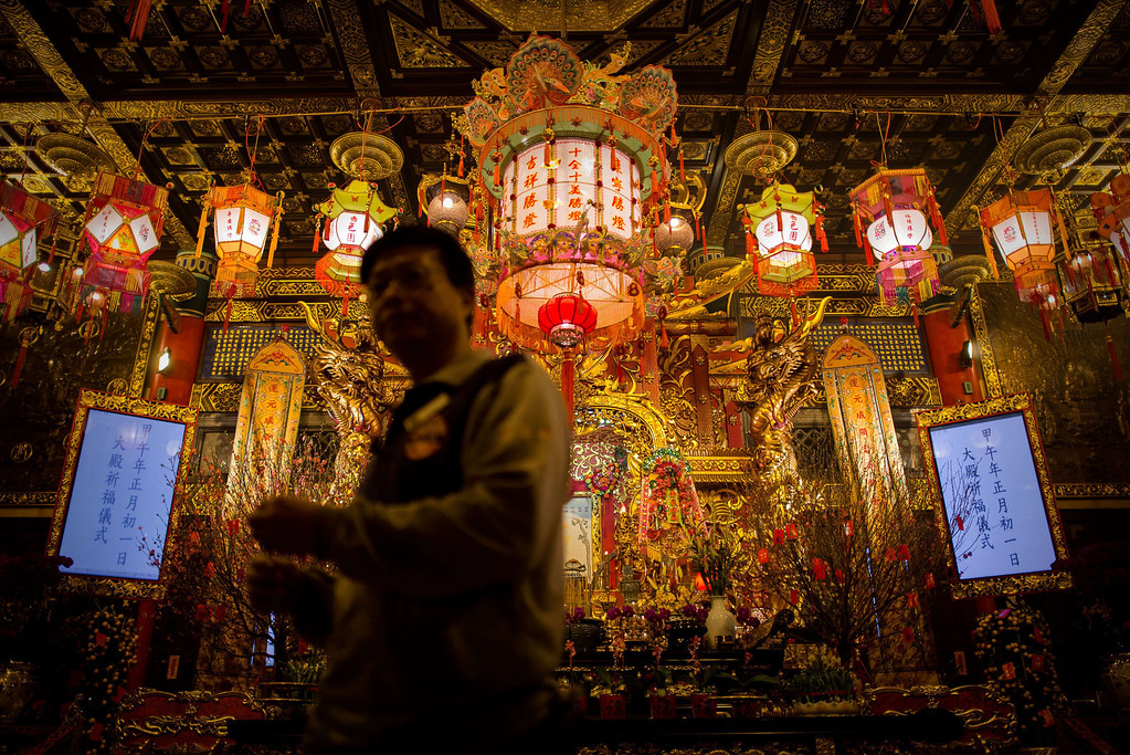 . A man walks past an altar at the Wong Tai Sin Temple to welcome the Chinese New Year of the horse in Hong Kong on January 30, 2014. Tens of thousands of worshippers flocked to temples across to pray for good luck and fortune for the new year.  AFP PHOTO / Philippe LOPEZ/AFP/Getty Images