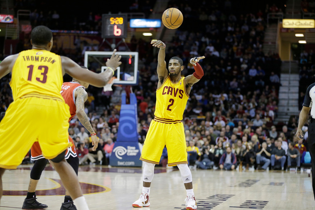 . Cleveland Cavaliers\' Kyrie Irving (2) passes to Tristan Thompson (13) in an NBA basketball game against the Milwaukee Bucks Friday, Jan. 25, 2013, in Cleveland. (AP Photo/Mark Duncan)