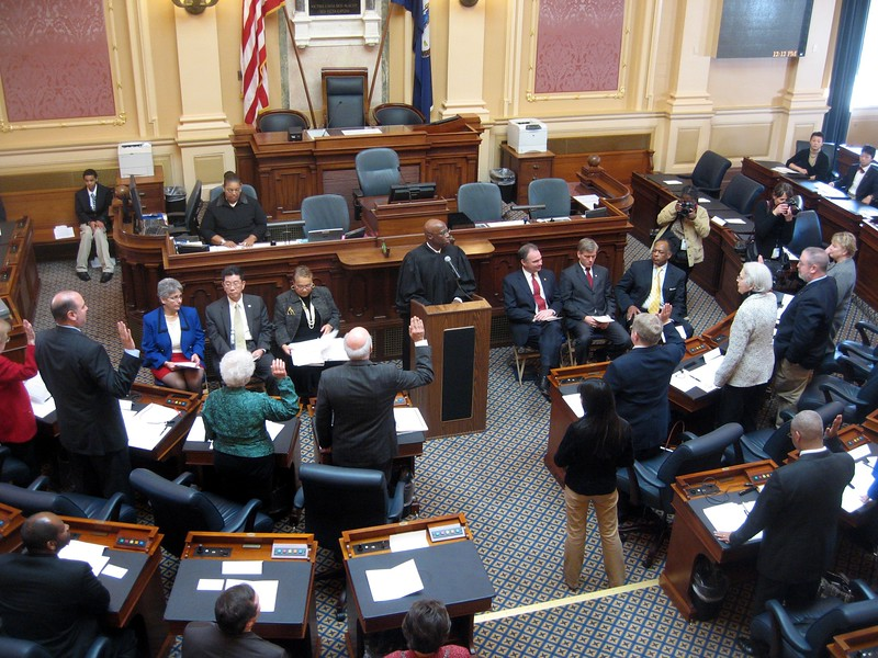 Chief Justice of Virginia Leroy Hassell administers the oath of office to the electors