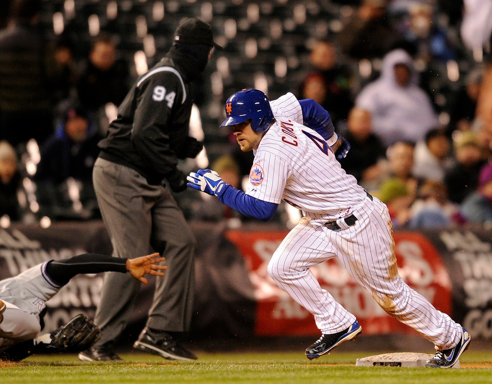 . DENVER, CO. - APRIL 16:  Mets baserunner Collin Cowgill scored from third after an attempt by Yorvit Torrealba to pick him off third base sailed over Chris Nelson\'s head into the outfield. The Colorado Rockies hosted the New York Mets in the second game of a doubleheader Tuesday night, April 16, 2013. Monday night\'s game was snowed out at Coors Field.  Photo By Karl Gehring/The Denver Post)