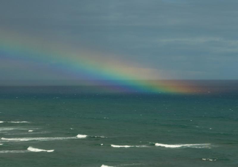 Rainbow into the ocean near Diamond Head  O'ahu, Hawai'i