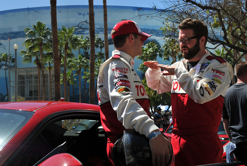 . 4/19/13 - L-R Tyler Clary and Rutledge Wood discuss strategy before the Friday morning practice of the Toyota Pro/Celebrity race at the 39th Annual Toyota Grand Prix of Long Beach. Photo by Brittany Murray / Staff Photographer