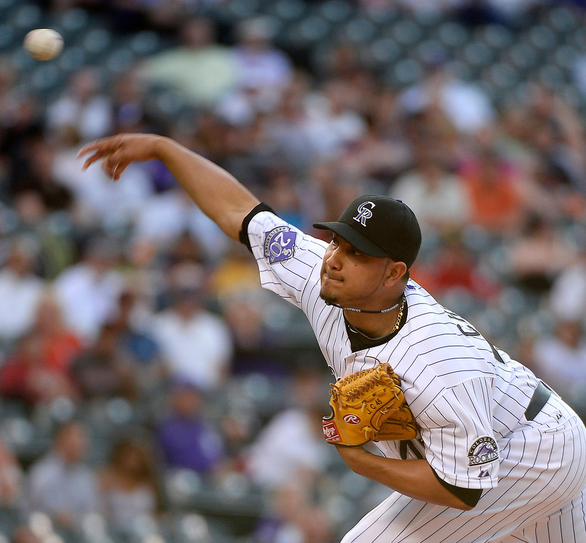 . Jhoulys Chacin (45) of the Colorado Rockies delivers a pitch in the first inning against the San Francisco Giants May 16, 2013 at Coors Field. (Photo By John Leyba/The Denver Post)