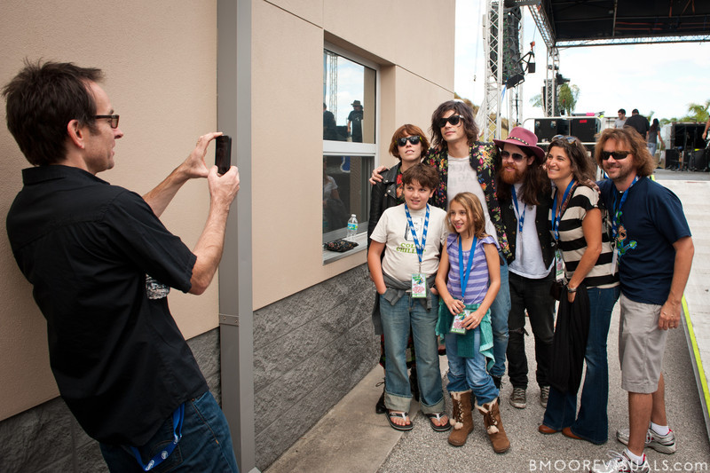 Hannah Hooper, Christian Zucconi, and Sean Gadd of Grouplove pose with fans backstage on December 3, 2011 during 97X Next Big Thing at 1-800-ASK-GARY Amphitheatre in Tampa, Florida
