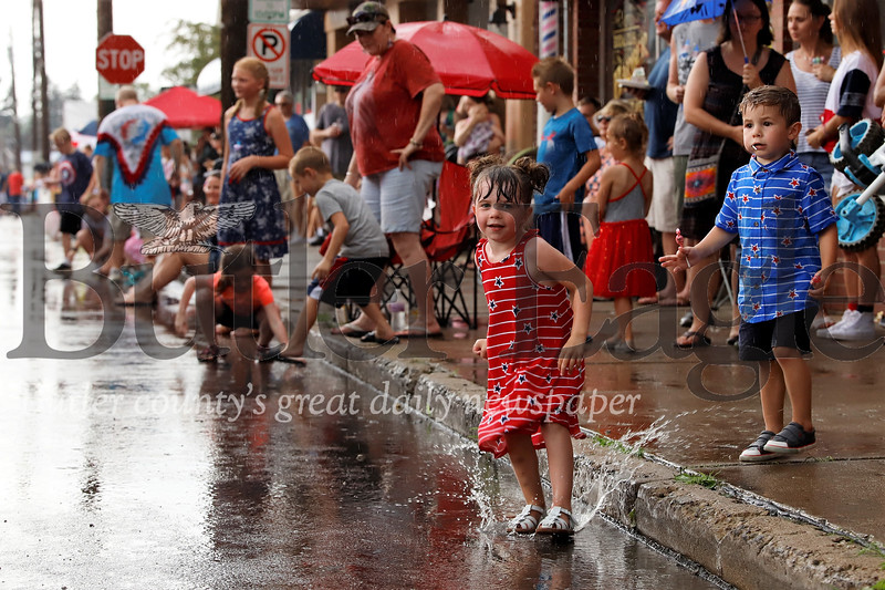 Kids in Mars didn't mind rain for the Fourth of July Parade Thursday. Free candy and a chance to splash in puddles more than made up for it. Seb Foltz/Butler Eagle
