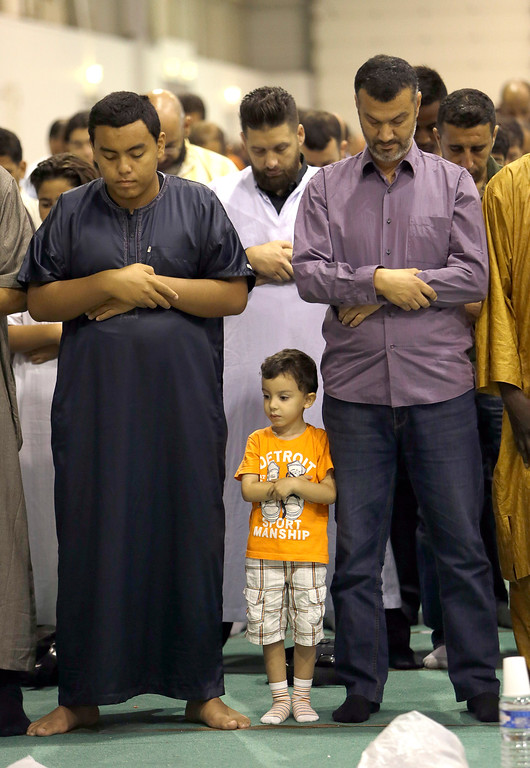 . Muslims offer Eid al-Adha prayers in a convention center in Marseille, southern France, Monday, Sept. 12, 2016. Muslims around the world will celebrate Eid al-Adha in local language, the Festival of Sacrifice, to mark the end of the hajj pilgrimage by slaughtering sheep, goats, cows and camels to commemorate Prophet Abraham\'s readiness to sacrifice his son Ismail on God\'s command. (AP Photo/Claude Paris)