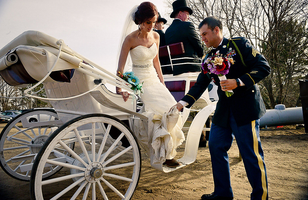. Bauman and Collins get off a horse drawn carriage after being married at Hope Glen Farm in Cottage Grove on Friday, April 11, 2014. (Pioneer Press: Ben Garvin)