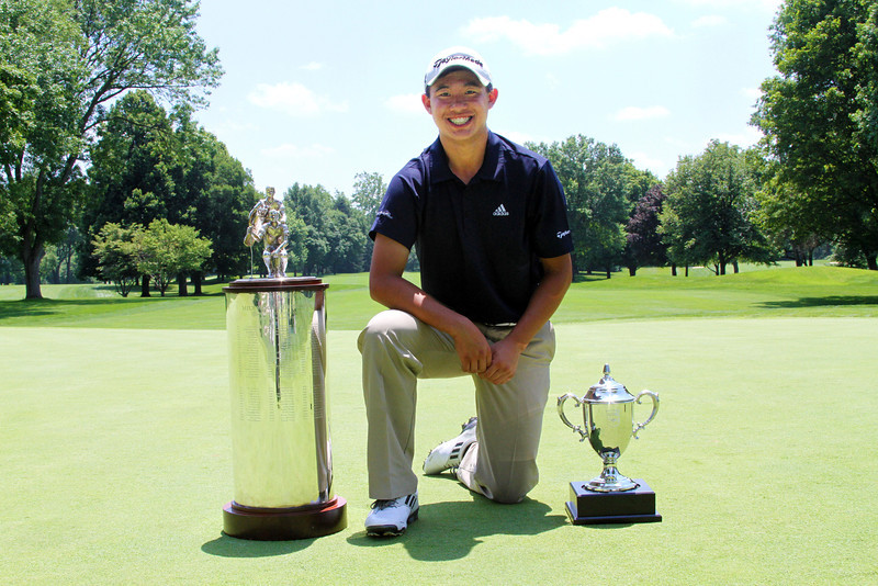 Collin Morikawa poses with his hardware on the 18th green of Meridian Hills Country Club at the conclusion of the 96th Western Junior Championship.