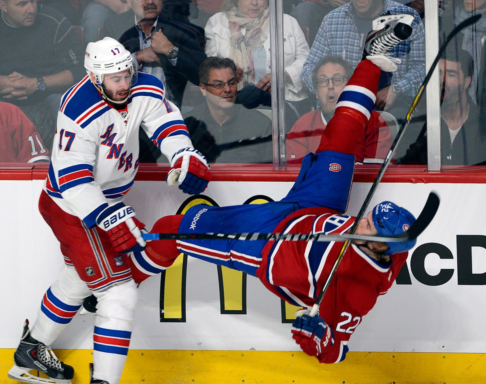 . New York Rangers defenseman John Moore (17) checks Montreal Canadiens right wing Dale Weise (22) during the first period of Game 5 of the NHL hockey Stanley Cup playoffs Eastern Conference finals, Tuesday, May 27, 2014, in Montreal. (AP Photo/The Canadian Press, Ryan Remiorz)