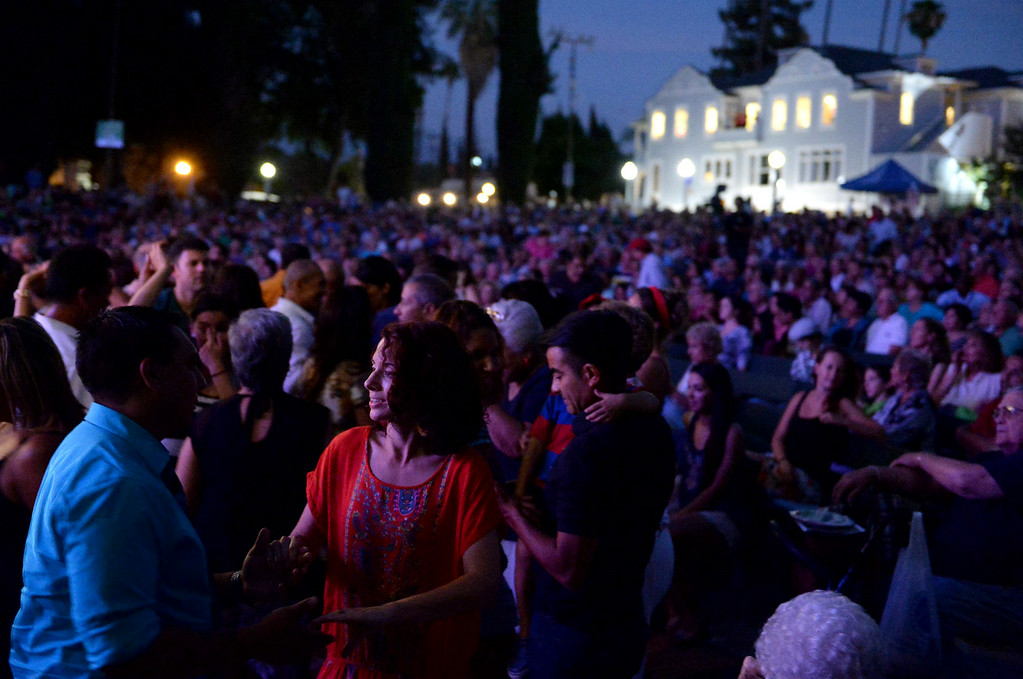 . People dance as Adonis Puentes and the Voice of Cuba orchestra perform at the Redlands Bowl on Friday, July 11, 2014 in Redlands, Ca. (Micah Escamilla/Redlands Daily Facts)