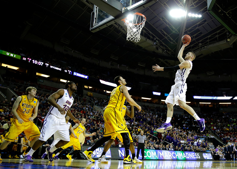 . Northern Iowa forward Seth Tuttle, right, jumps to shoot against Wyoming during the first half of an NCAA tournament college basketball game in the Round of 64 in Seattle, Friday, March 20, 2015. (AP Photo/Ted S. Warren)