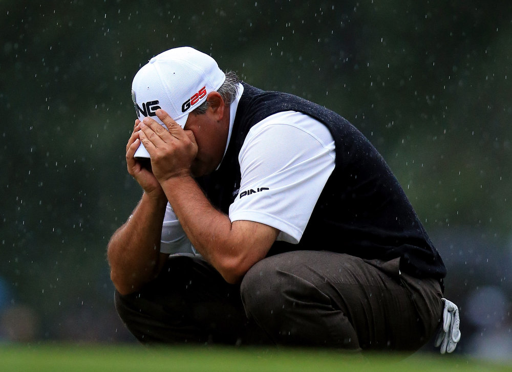 Description of . Angel Cabrera of Argentina reacts after a missed shot on the 17th hole during the final round of the 2013 Masters Tournament at Augusta National Golf Club on April 14, 2013 in Augusta, Georgia.  (Photo by David Cannon/Getty Images)