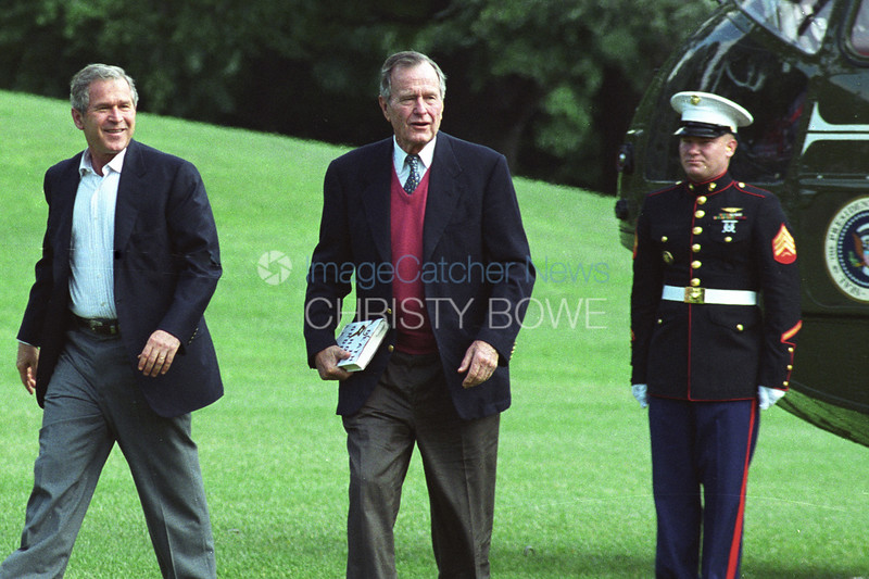 Presidents Bush # 43 and # 41 exit Marine one on The South Lawn of The White House.