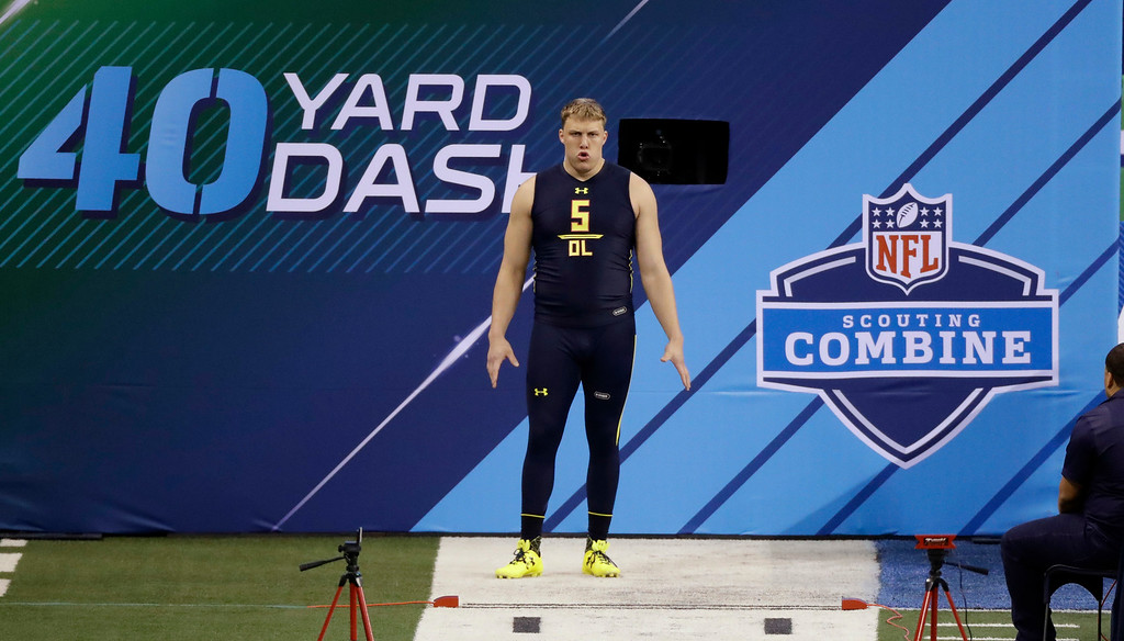 . Utah offensive lineman Garett Bolles runs the 40-yard dash at the NFL football scouting combine Friday, March 3, 2017, in Indianapolis. (AP Photo/David J. Phillip)