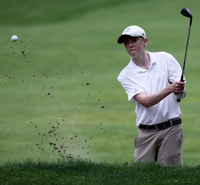 Andrew Lack, Detroit Catholic Central, chips his way out of sand trap during Region 3 championship golf action at Dunham Hills Golf Club in Hartland Thursday, May 31, 2018. (For The Oakland Press / LARRY McKEE)