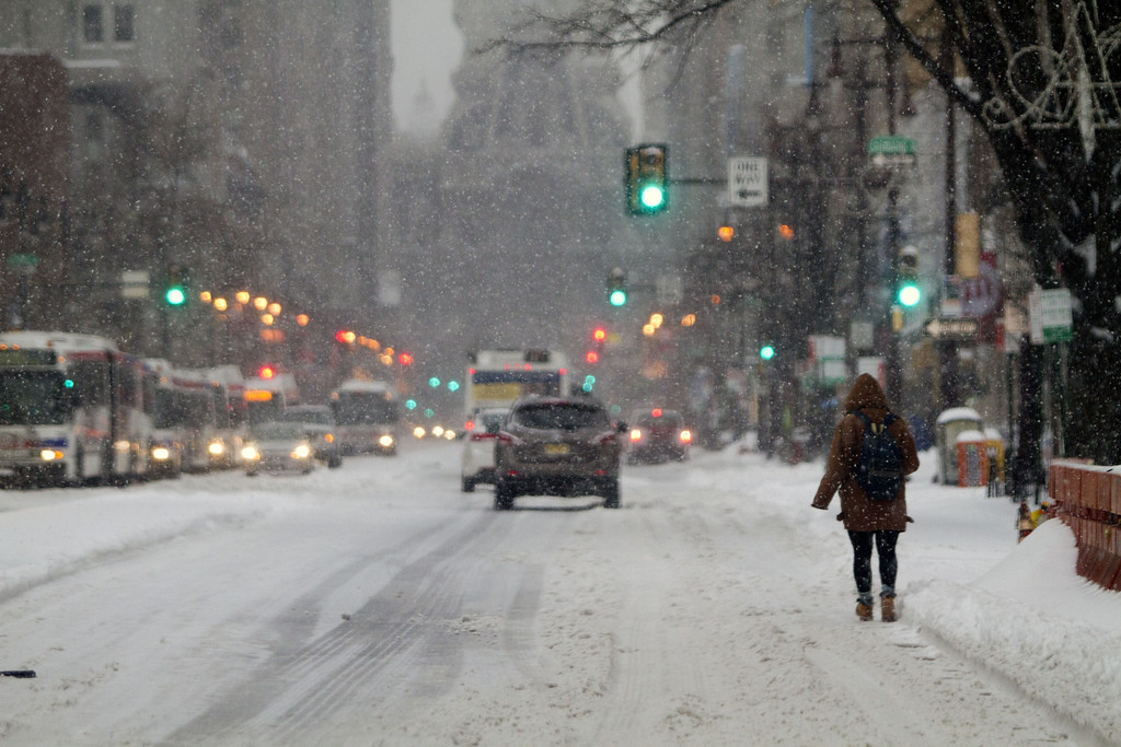 . Residents walk through the snow covered streets on February 13, 2014 in Philadelphia, Pennsylvania. The east coast was hit with a winter snowstorm bringing sleet and snow. (Photo by Jessica Kourkounis/Getty Images)