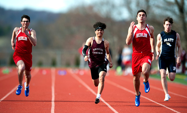 4/16/2019 Mike Orazzi | Staff Berlin's Ben Labadia, Bristol Central's Ramon Ambert and Berlin's Alex Halkias during Tuesday's track meet at Bristol Central High School.