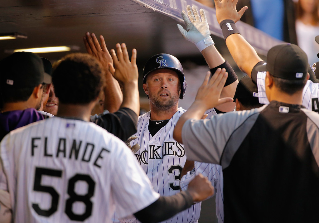 . DENVER, CO - SEPTEMBER 18:  Michael Cuddyer #3 of the Colorado Rockies celebrates his solo home run off of starting pitcher Vidal Nuno #54 of the Arizona Diamondbacks to give the Rockies a 1-0 lead in the second inning at Coors Field on September 18, 2014 in Denver, Colorado.  (Photo by Doug Pensinger/Getty Images)