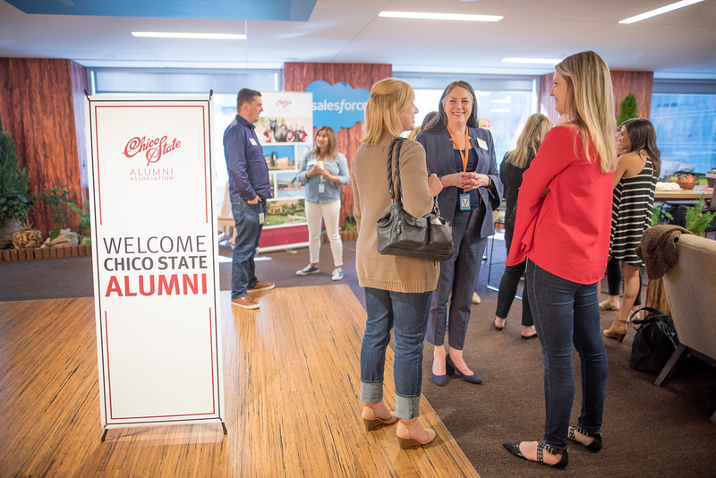Evelyn Buchanan (right center) enjoys a conversation at Chico State's Alumni Day at Salesforce West on Thursday, May 10, 2018 in San Francisco, Calif. (Jessica Bartlett /University Photographer/CSU Chico)