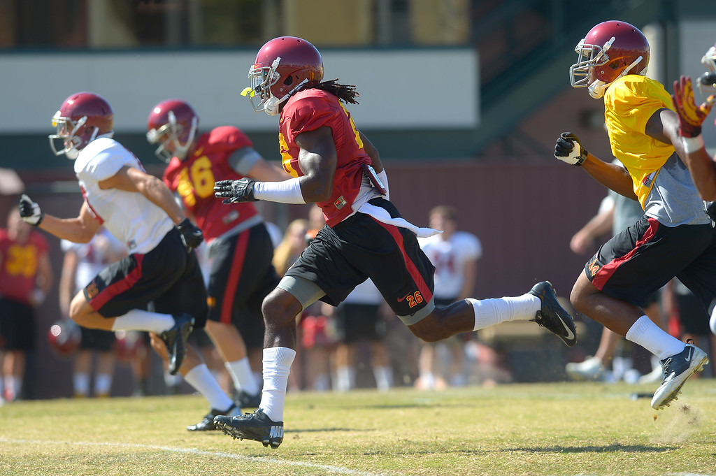 . USC players run a drill August 20, 2013.(Andy Holzman/Los Angeles Daily News)