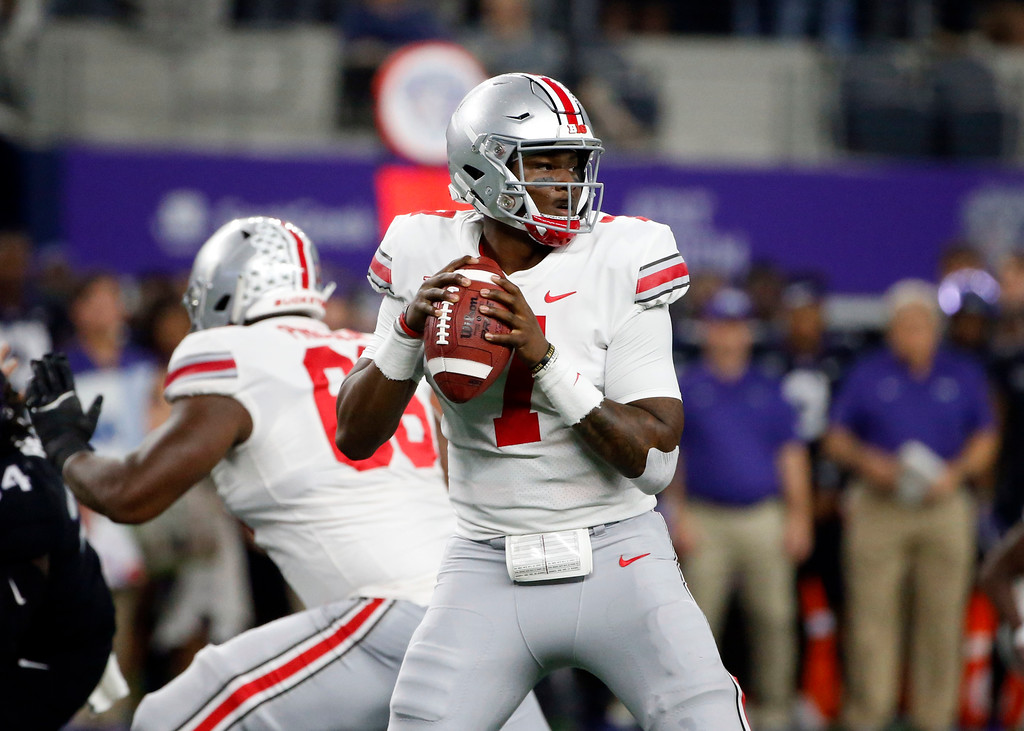 . Ohio State quarterback Dwayne Haskins (7) looks to throw against TCU during the first half of an NCAA college football game in Arlington, Texas, Saturday, Sept. 15, 2018. (AP Photo/Michael Ainsworth)