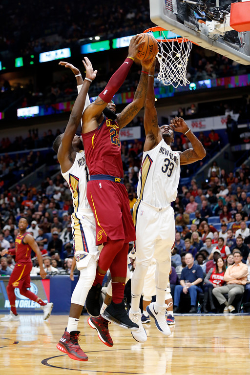 . Cleveland Cavaliers forward LeBron James (23) goes to the basket against New Orleans Pelicans forward Dante Cunningham (33) and forward Cheick Diallo in the first half of an NBA basketball game in New Orleans, Saturday, Oct. 28, 2017. (AP Photo/Gerald Herbert)