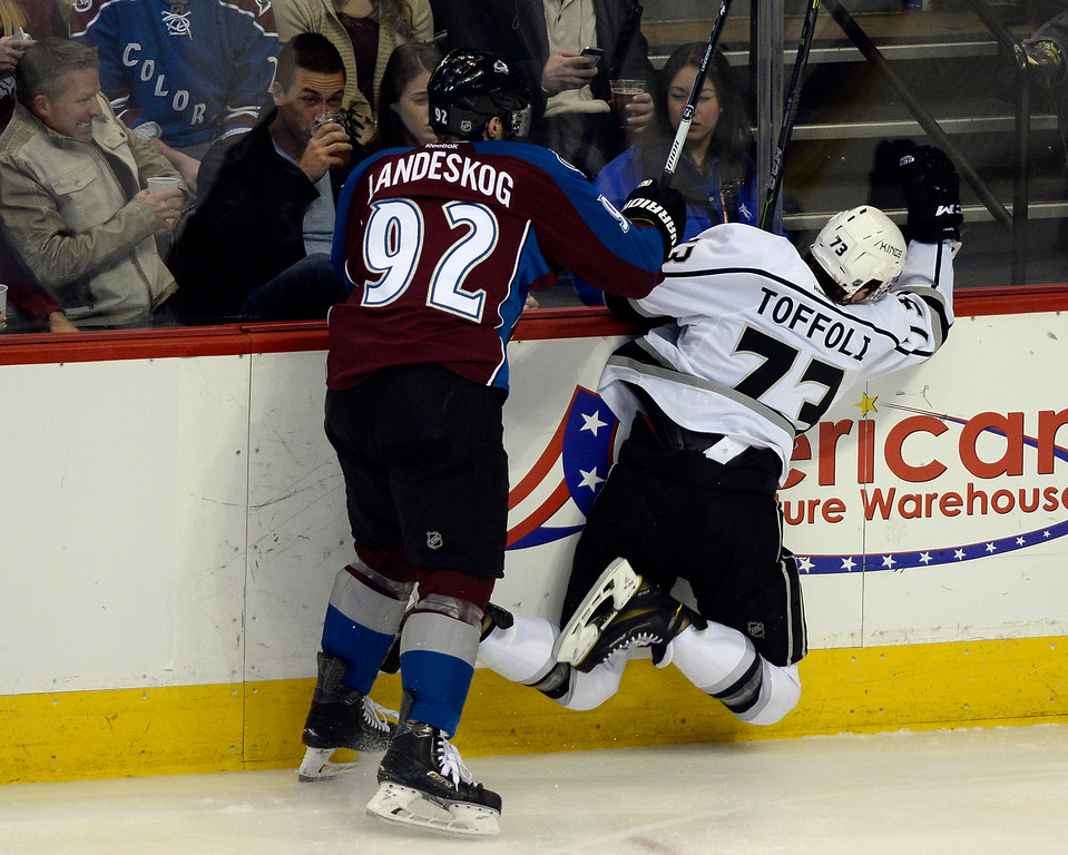 . DENVER, CO - FEBRUARY 18: Colorado Avalanche left wing Gabriel Landeskog (92) hits Los Angeles Kings center Tyler Toffoli (73) up against he boards during the second period February 18, 2015 at Pepsi Center. (Photo By John Leyba/The Denver Post)