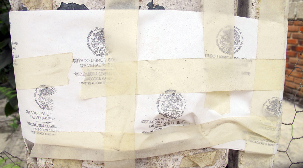 . A rudimentary seal of paper and tape blocks entry to the home of Regina Martinez April 12, 2013, a reporter for the Proceso newsweekly in Mexico, who was slain in late April 2012. (Tim Johnson/MCT)