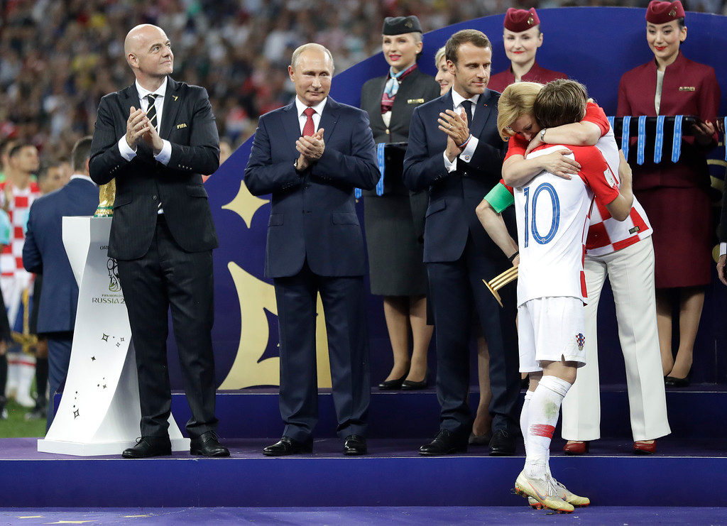 . Croatian President Kolinda Grabar-Kitarovic embraces Croatia\'s Luka Modric after he received the player of the tournament award after the final match between France and Croatia at the 2018 soccer World Cup in the Luzhniki Stadium in Moscow, Russia, Sunday, July 15, 2018. France won the final 4-2. (AP Photo/Matthias Schrader)