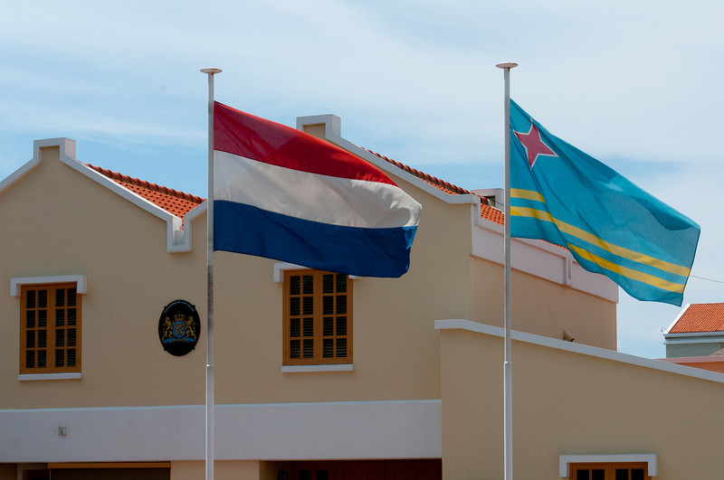 Flags in front of Parliament Building in Aruba