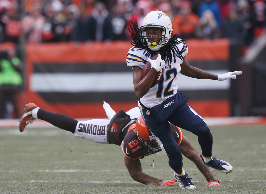 . San Diego Chargers wide receiver Travis Benjamin (12) avoids a tackle by Cleveland Browns cornerback Jamar Taylor (21) in the first half of an NFL football game, Saturday, Dec. 24, 2016, in Cleveland. (AP Photo/Aaron Josefczyk)