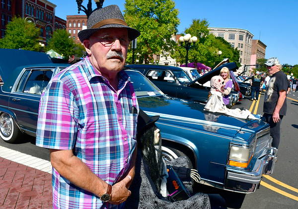 9/21/2019 Mike Orazzi | StaffrJames Hellandbrand with his 1986 Cadillac Fleetwood Rome during the New Britain Downtown District's 13th annual car show on Saturday.