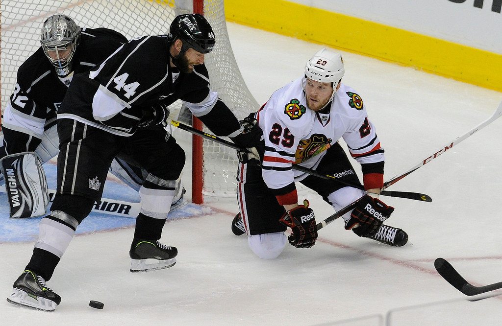 . Kings#44 Robyn Regehr will not allow Blackhawks#29 Bryan Bickell to get near the goal in the 3rd period. The Kings defeated the Chicago Blackhawks in the 3-1 in the 3rd game of the Western Conference Finals. Los Angeles, CA 6/4/2013(John McCoy/LA Daily News4