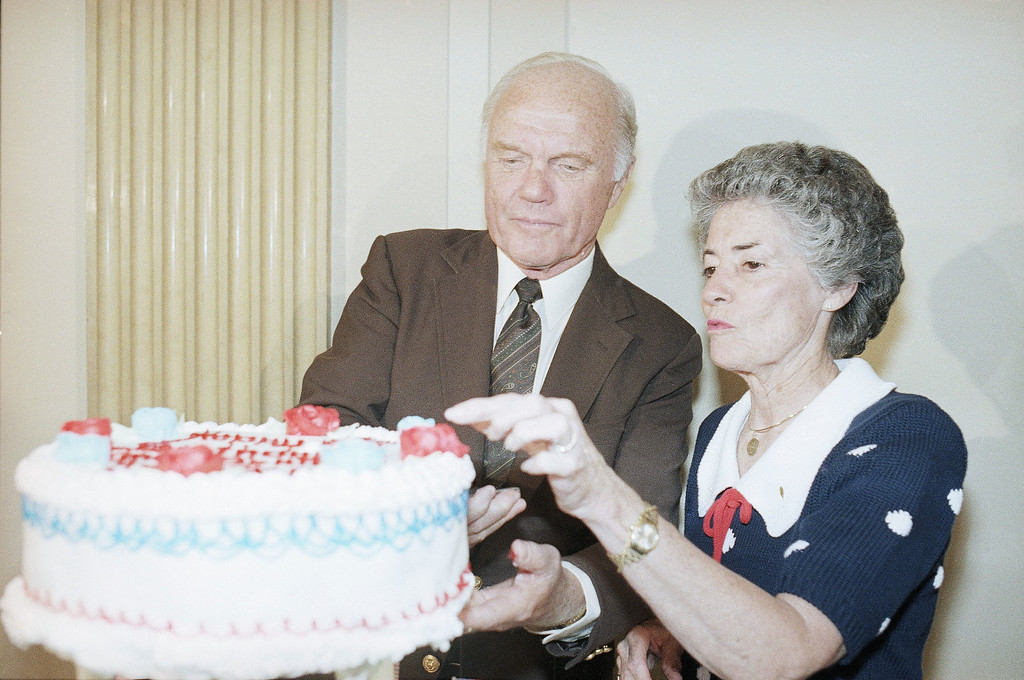 . Sen. John Glenn, D-Ohio, left, cuts a piece of birthday cake as his wife Annie reaches for icing during a surprise birthday party in his honor on Capitol Hill, Thursday, July 17, 1986, Washington, D.C. Glenn will be 65-years-old on Friday. (AP Photo/Lana Harris)