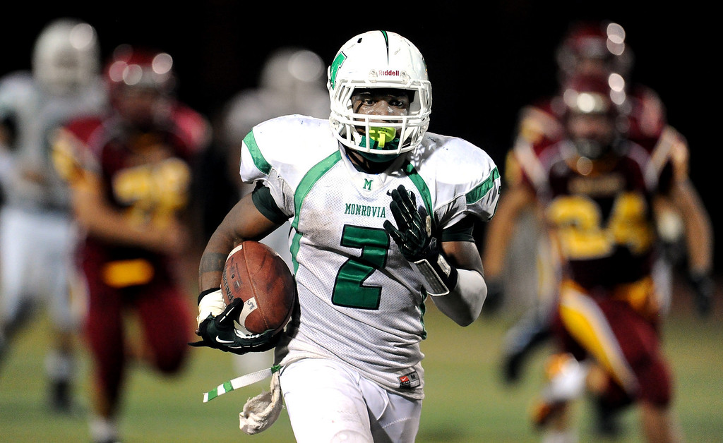 . Monrovia\'s Kurt Scoby (2) runs for 45 yard touchdown against Arcadia in the first half of a prep football game at Arcadia High School in Arcadia, Calif. on Friday, Sept. 13, 2013.   (Photo by Keith Birmingham/Pasadena Star-News)