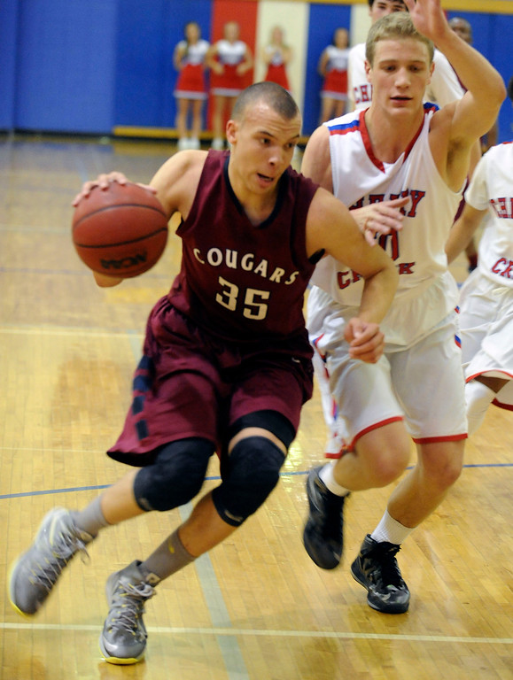. GREENWOOD VILLAGE, CO. - FEBRUARY 13: Roderick Bernstine of Cherokee Trail drives to the basket against Graham Pingree in the first half Wednesday night at Cherry Creek High School. (Photo by Steve Nehf, The Denver Post)