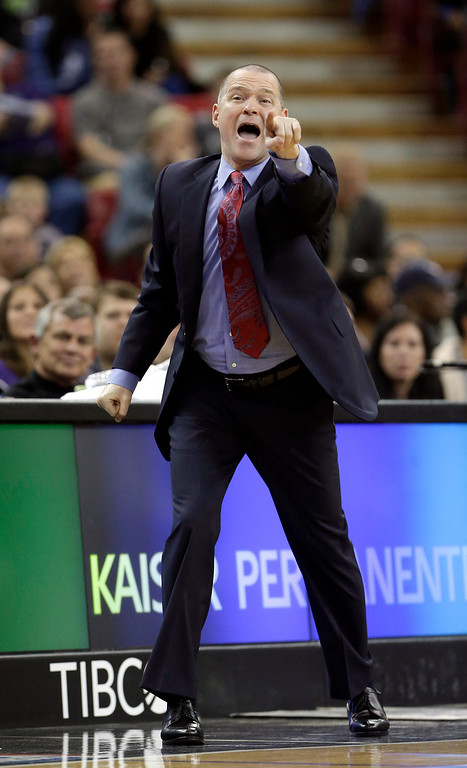 . Sacramento Kings head coach Michael Malone shouts out instructions to his team during the fourth quarter against the Denver Nuggets in a NBA basketball game in Sacramento, Calif., Sunday, Jan. 26, 2014. The Nuggets won 125-117.(AP Photo/Rich Pedroncelli)